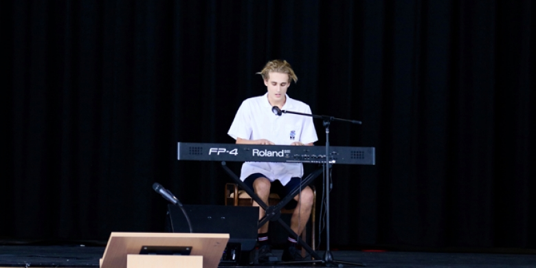 Harry Hughes performs at Secondary Chapel