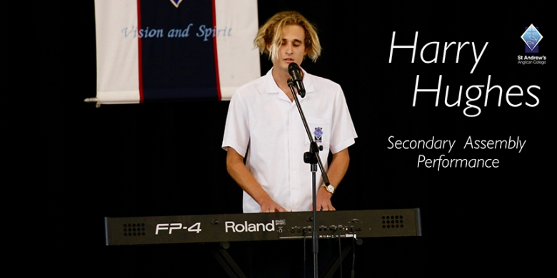 Harry Hughes performs at Secondary Assembly