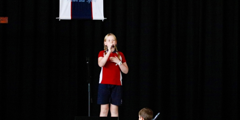 Harriet Wensley performs at Primary Assembly