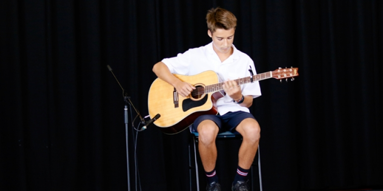 Reid Peebles performs at Secondary Assembly